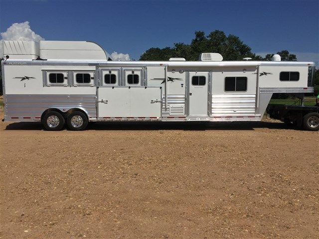 SALE PRICE $106,500 2017 4 horse 15 short wall 8 wide 7.6 tall reverse load 8000lb axles blocked 3 inches Continental 18 ply 17.5 tires and Alcoa aluminum wheels white skin 6ft haypod and generator compartment on roof 50/50 rear doors drops on head drop down window bars on head drops on rump propane brackets extra water tank in rear tack 3 mangers w/ 3 manger doors escape door at last horse Ac braces