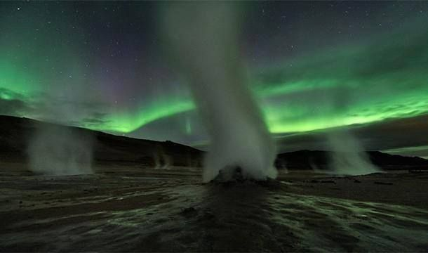 Aurorae shimmering over the steaming Earth. Geysers and hot springs occur when water gets superheated by underlying magma chambers filled with molten rock. A convection cell of sinking rainwater and rising superheated H2O establishes itself, dissolving and redepositing minerals as it cycles up and down through the energy gradient.