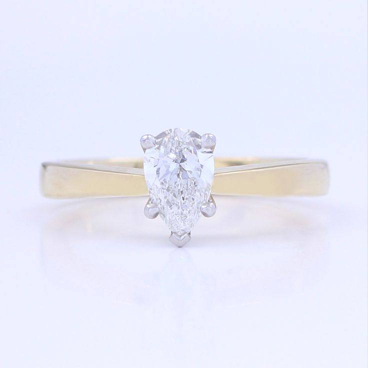 Diamond Engagement Ring was $4,900 now $4,410. 18 ct Yellow Gold / Platinum,  Pear diamond 0.501 ct G-H SI1+ Ex.  SKU: 10118   This ring is available online or in store at 98 Richmond Road, Grey Lynn.  Available in different diamond weights, gradings and metal, please enquire for prices.  All prices are in New Zealand Dollars including gst.  This item ships within New Zealand only.  Free delivery NZ wide. #engagement #ring #gold #engagementring