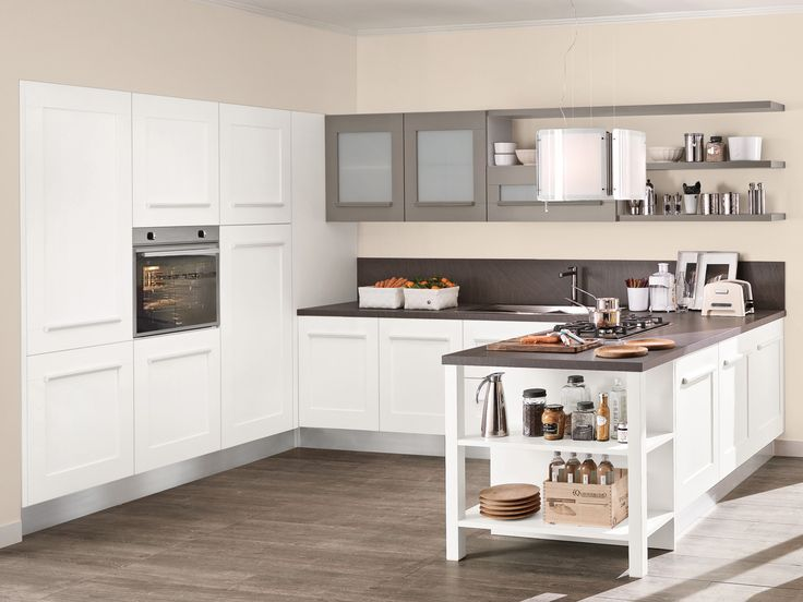 The classic-style doors emerge from this #modern #kitchen to create a perfect blend of #romantic charm and #minimal lines. A modern interpretation of ancient #traditions to the door with integrated handle and grip oval, that characterises the line becoming a #decorative #element, interchangeable with different types of handles, depending on your preference.