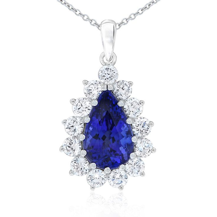 Rare and beautiful. Kilimanjaro tanzanite and diamond cluster style pendant. This pear cut tanzanite is a deep purple-blue colour. Crafted in 18ct white gold. The 18ct gold chain is adjustable from 42 - 45cm long.
