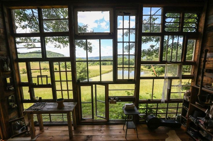 This Artist Couple Built An Incredible Cabin Out Of Recycled Windows For Under $500 - Higher Perspective
