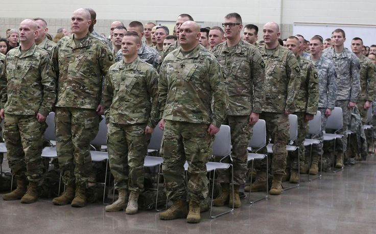 Sixty-six Wisconsin Army National Guard members stand during a sendoff ceremony in Madison Monday morning. The Wisconsin soldiers volunteered for the new unit assigned to the 101st Airborne as part of the first-ever Army initiative to integrate soldiers from the National Guard, reserves and active duty.