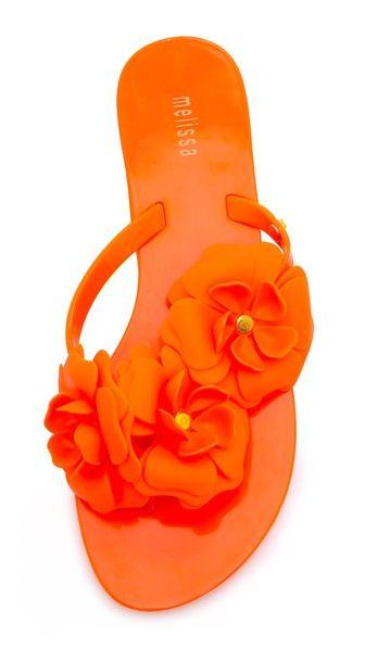 fun orange floral flip flops http://rstyle.me/n/w3yqhr9te