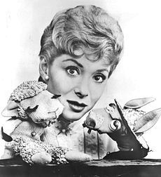 Shari Lewis (born, Sonia Phyllis Hurwitz) was an American ventriloquist, puppeteer, and children's television show host, most popular during the 1960s and 1990s. She was best known as the original puppeteer of Lamb Chop, first appearing on Hi Mom, a local morning show that aired on WRCA-TV (now WNBC-TV) in New York City. She died in 1998 at age 65 from complications due to breast cancer.