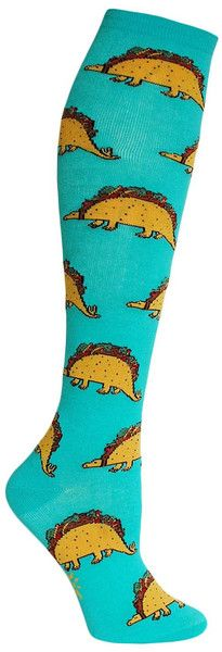 Ever wonder what a dinosaur tastes like? Turquoise knee high socks with delicious taco dinos. Fits women's shoe size 5-10.