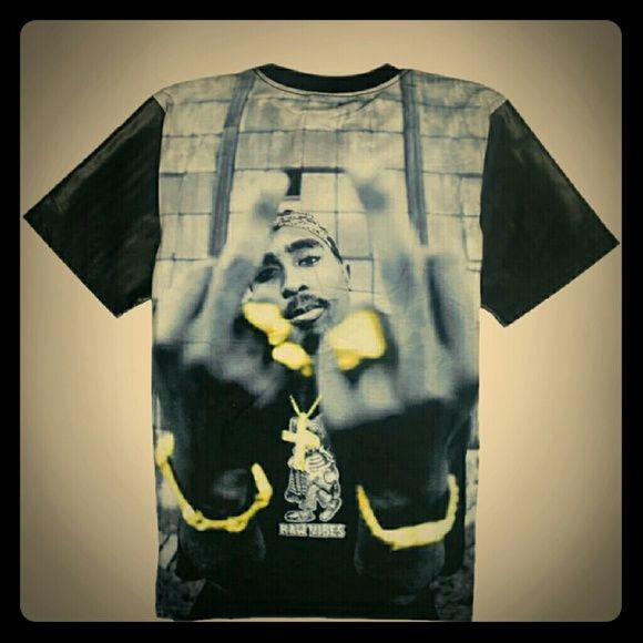 New large tupac shirt Brand new Men's large tupac shirt with Pleather sleeves. Tag says xxl but fits like a large Tops Tees - Short Sleeve