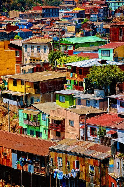 Valparaiso, CHILE. The colors on the houses in Valparaiso are incredible. The houses seem to be stacked on top of each other all the way to the ocean.