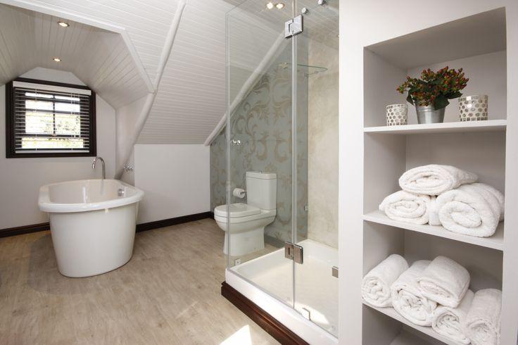 Studio room bathroom.  Bath & Shower.