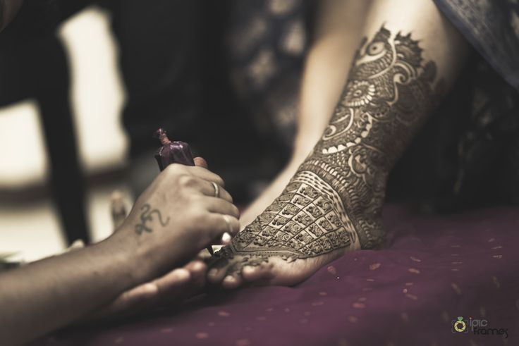 Khushboo & Praveen Engagement - Photo Courtesy ~ iPic Frames Bridal Feet Mehendi - Jaal Design Mehendi Designs Mehendi Designs - Bridal Feet Mehendi with Jaal and Peacock Designs | WedMeGood #wedmegood #feet #mehendi #peacock