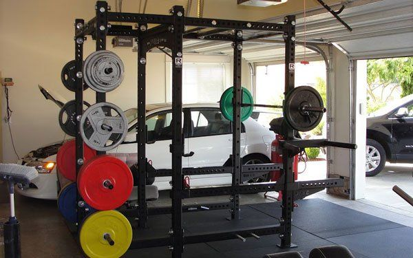 A clean garage gym with monster rack for more
