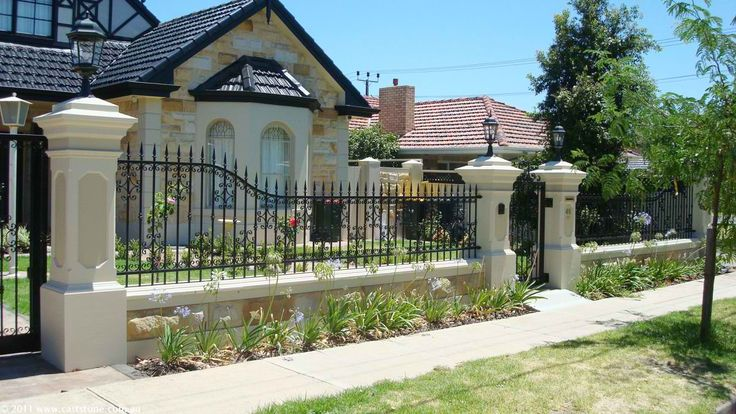 Fascinating Fence Landscape Idea Using Iron Fence with Gate and Small Garden Decor
