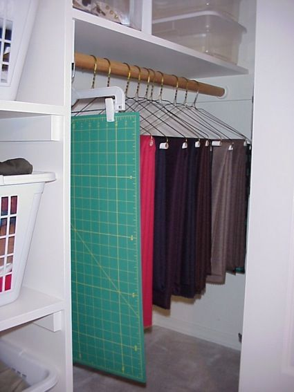 #papercraft #crafting supply #organization: Use a pant hanger to store cutting mats - keeps them from getting out of shape.
