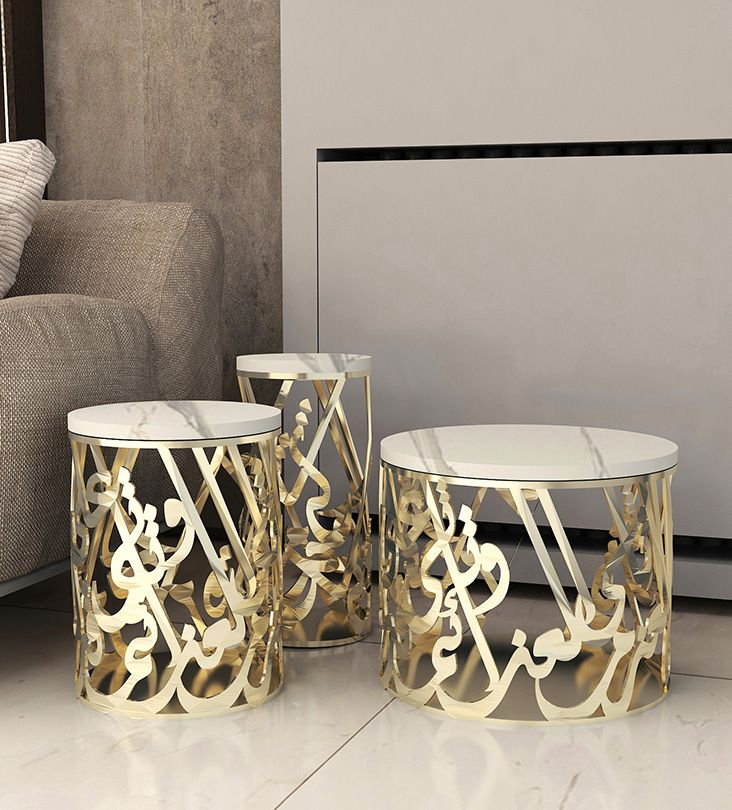 "Makarem Side Tables - This set of three striking side tables can also be used as a coffee table. The famous Arab poet Al Mutanabbi once said: ""Resolutions are measured according those who take them. And so much is true for generostiy and its givers"". A celebration of this classical poetic verse though premium craftsmanship belongs only in the grandest of homes."
