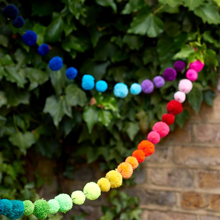 A rainbow coloured Pom Pom Garland makes an excellent alternative to bunting!