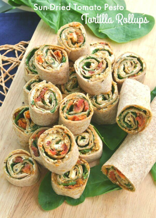 Sun Dried Tomato Pesto Tortilla Rollups has layers of flavor and texture that only takes 15 minutes to prepare.  Healthy appetizer that everyone loves.