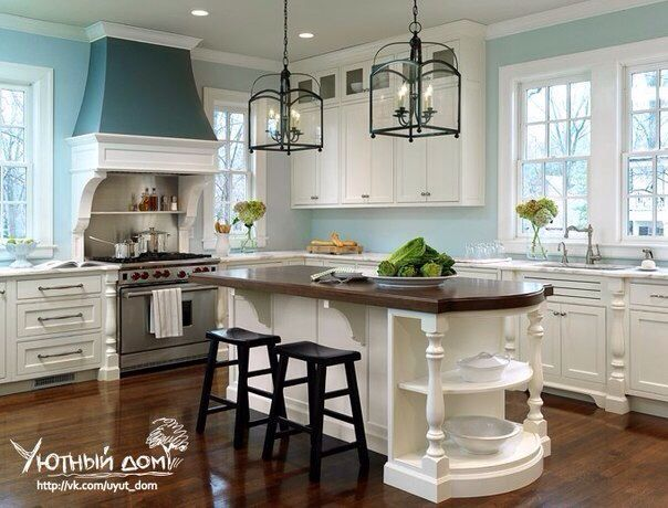 Love the wall color and that range hood