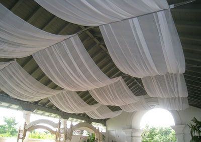 fabric draped on ceiling- try this on the ceiling in you unfinished basement ceiling.