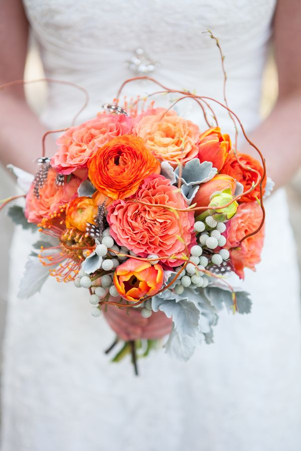 I like the different shapes and rustic feel of this bouquet. Like the vibes/branches. Different colors obviously