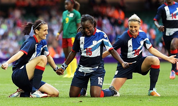 Jill Scott, Eni Aluko and Kelly Smith celebrate Team GB's second goal against Cameroon