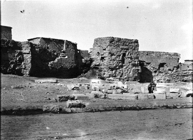 Konya-Remains of City wall. Man seated in foreground .    Date taken: May 1905	 Photographer: Gertrude Bell Location: Konya - Turkey Modern location: Karaman (Laranda) Subject date: Seljuk 1220-1221