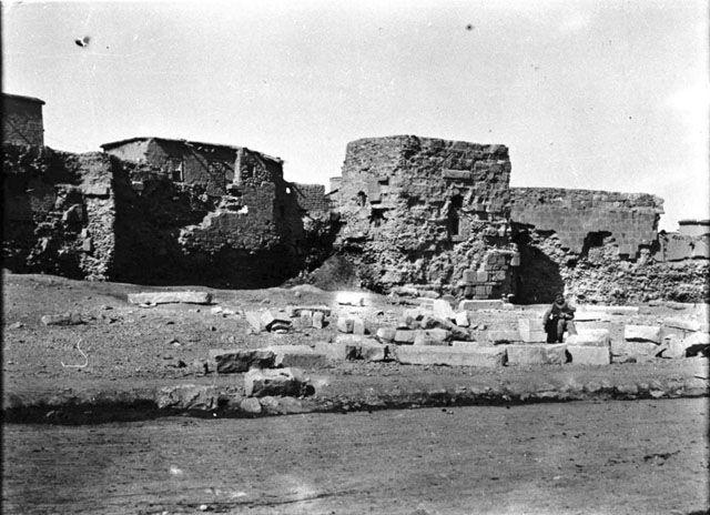 Konya-Remains of City wall. Man seated in foreground .    Date taken: May 1905 Photographer: Gertrude Bell Location: Konya - Turkey Modern location: Karaman (Laranda) Subject date: Seljuk 1220-1221