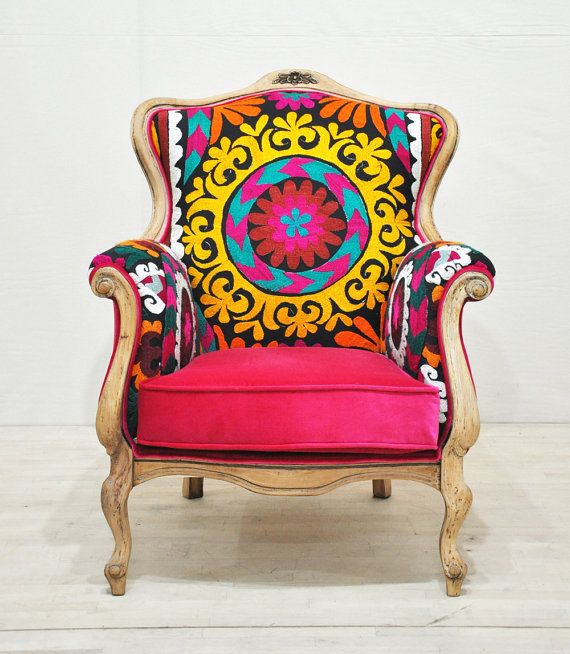Bohemian style vintage armchair upholstered with Suzani and pink velvet fabrics. Frame is made of beech wood and removed out the old paint.