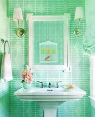 Bright green bathroom tiles bring a pretty pop of fun. #colors #bathrooms #tile