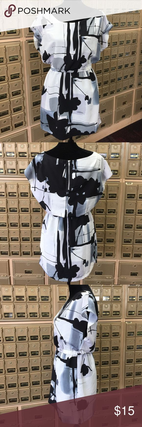 Forever Twenty One Mini Dress Size Medium Cute used mini dress, forever twenty one black and white abstract design, elastic waist. Please see pictures for details. Bundle and save! Twenty One Dresses Mini