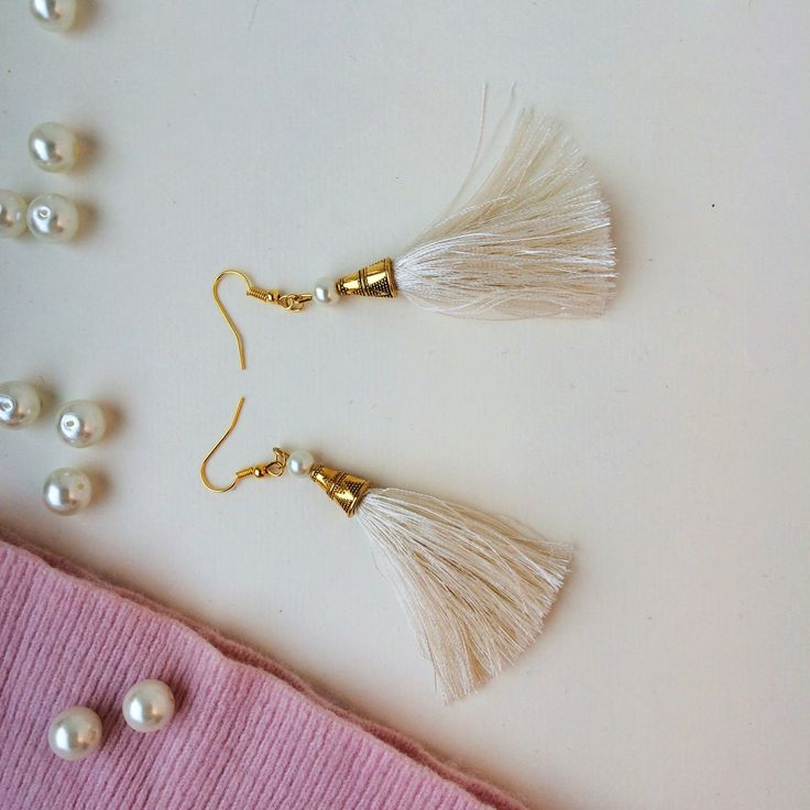 A personal favourite from my Etsy shop https://www.etsy.com/listing/485259459/pearl-cream-tassel-earrings-tassel Tassel earrings, pearl earrings, pearl accesories