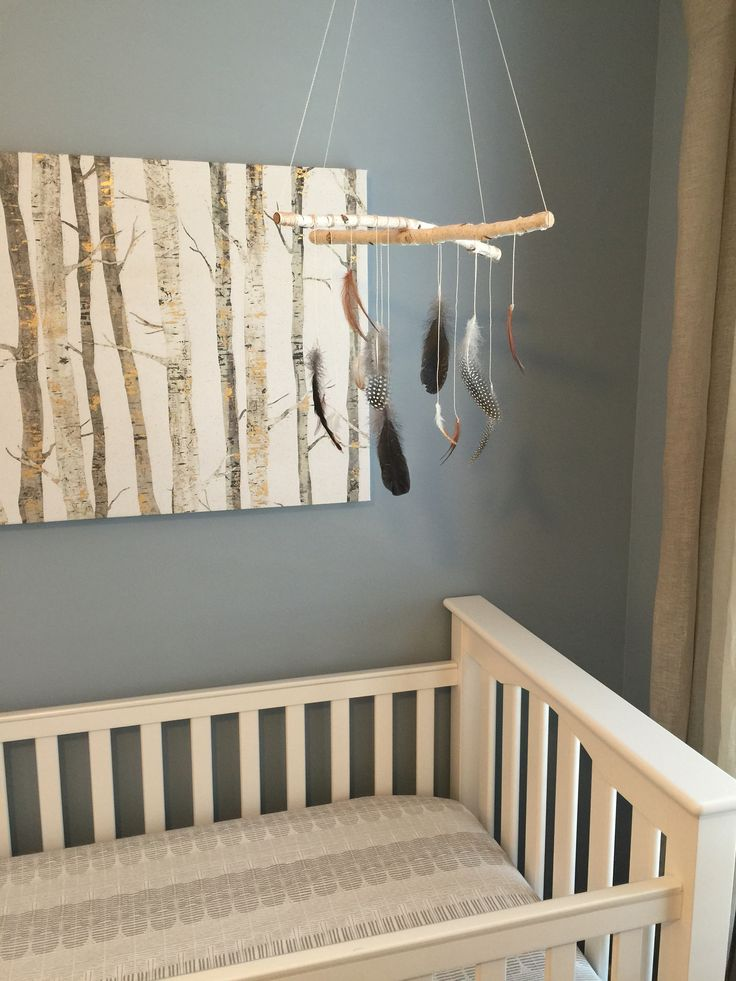 Homemade dream catcher feather mobile. Inspired by the birch tree outside Rye's window. Tribal inspired nursery. Pottery Barn crib and bedding.