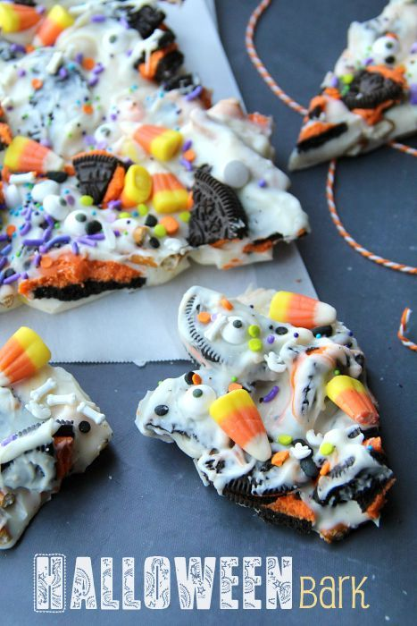 Halloween Bark - 12-14 orange and black oreo cookies, broken up into large chunks 1 cup pretzels, broken into pieces 1 pound almond bark or white chocolate melts 1 1/2 cups candy corn 20-30 candy eyeballs 1-2 tablespoons of a variety of Halloween food sprinkles.