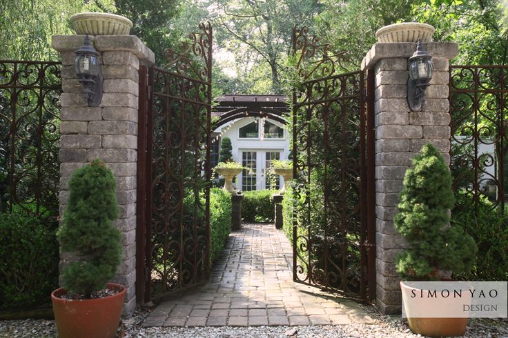 Garden house walkway with wrought iron gate