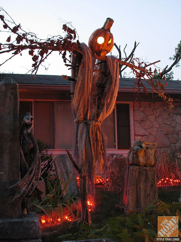 Homemade Halloween Decorations: Tree limbs are a great form for these spooky scarecrows