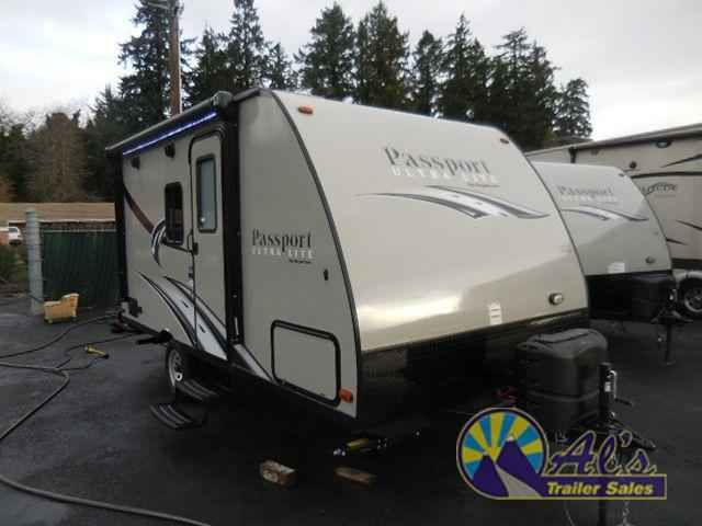 2016 New Keystone Rv Passport 151ML Express Travel Trailer in Oregon OR.Recreational Vehicle, rv, 2016 Keystone RV Passport 151ML Express, This rear bath Passport Express model 151ML features a front sofa and Murphy bed.As you enter the trailer to your right is a front sofa and indoor/outdoor table during the daytime, and a Murphy bed with dual bedside wardrobes for your clothes at night. The kitchen begins to the left of the entry door and features a double sink, three burner range, and…