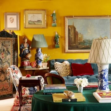 Egg Yolk Yellow walls in a living room by Miles Redd