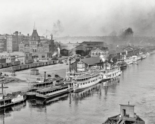 """The Mississippi River circa 1908. """"Steamboat landing and Union Station at St. Paul, Minnesota."""" Sidewheelers and sternwheelers on view…"""