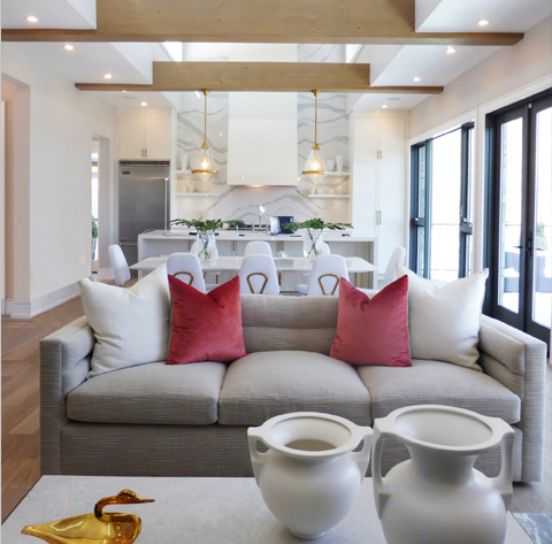 #Highview house from #BryanInc seen on #HGTVCanada Living room and kitchen view. Furniture by Cocoon: #Melrose sofa, #Gale lantern, #GrecianAmphorosa vases. #bryanbaeumler #sarahbaeumler