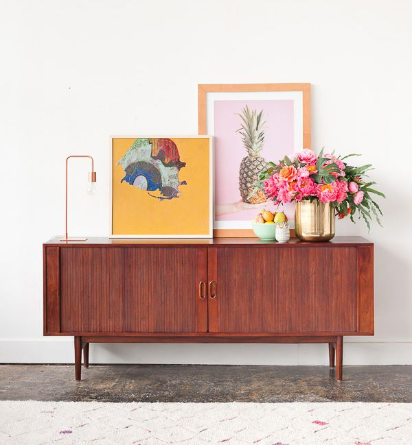 The MidCentury inspired Anders Sideboard features tambour doors, plenty of interior storage, and is finished with a warm mahogany stain | Gorgeous styling by the Paper & Stitch blog