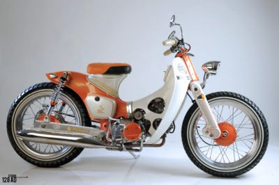 Mode Of Trasportation| Serafini Amelia| Orange streetcub by Newspeed Garage