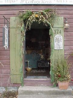 Primitive Entrance...with weathered green shutters & swag.