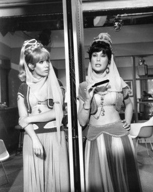 "Barbara Eden in a b/w shot from one of the few but famous split-screen episodes of ""I Dream of Jeannie,"" where she plays both ""Jeannie"" and ""Jeannie II"" (her sister)."