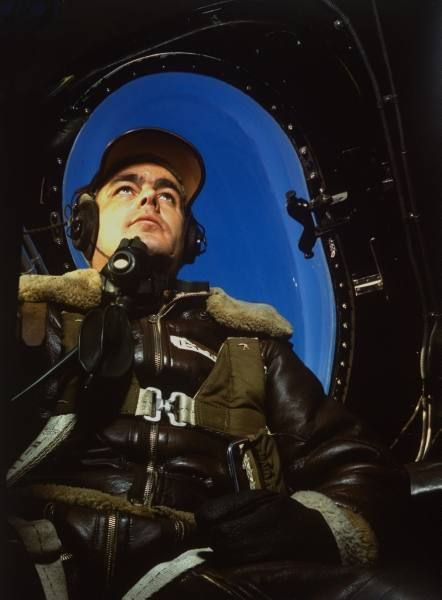 Fortune Color February 1942. Pilot in US mil. leather jacket w. oxygen mask around his neck sitting in plane cockpit (no caps). | Date: 1942 | Photographer: Dmitri Kessel | LIFE archive - Hosted by Google