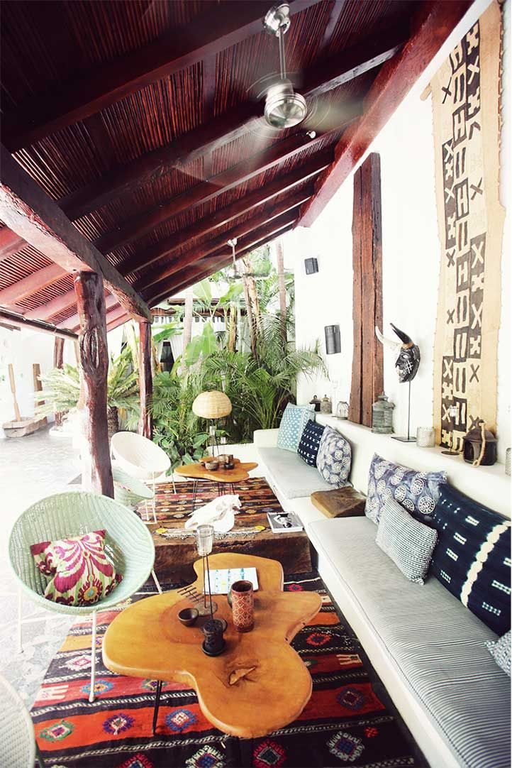 A covered veranda provides an outdoor, communal living & dining area