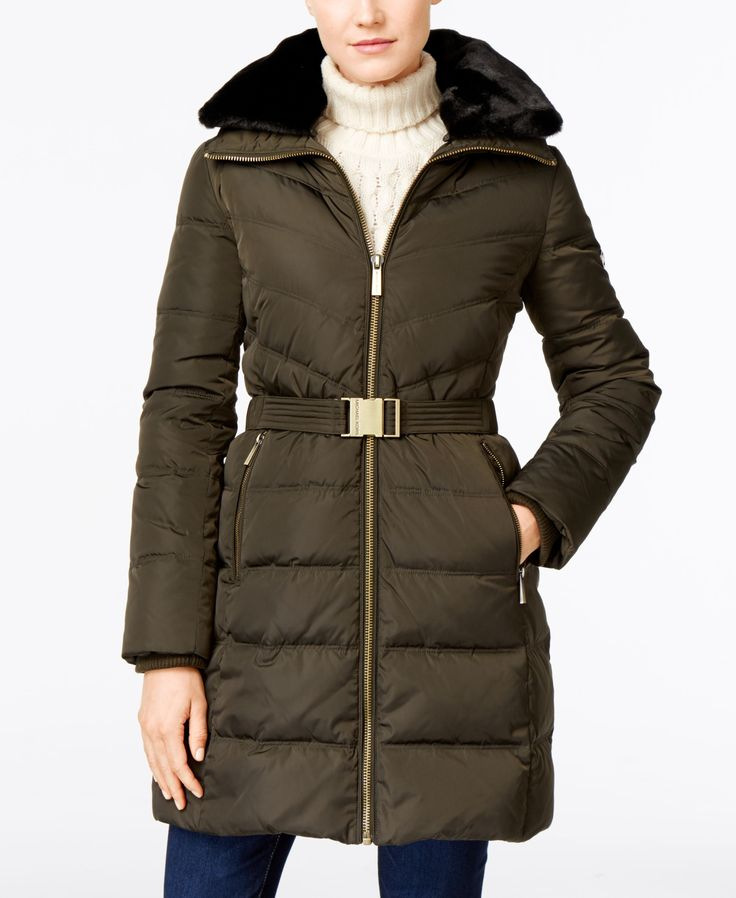 Michael Michael Kors' belted puffer coat is lined in faux fur along the collar for extra warmth in any weather. | Polyester; lining & hood fill: polyester; fill: down/feathers; faux fur: acrylic/polye