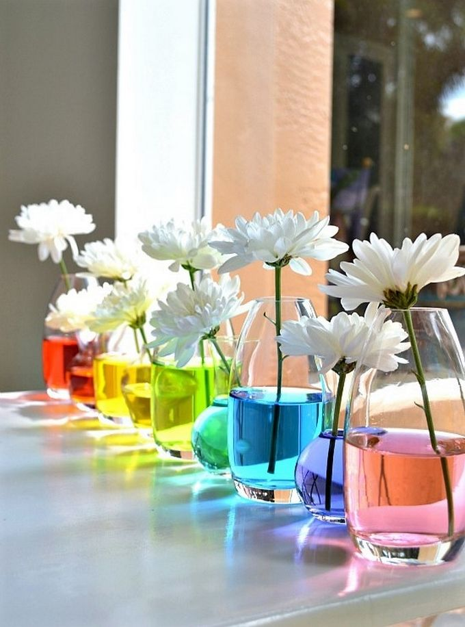 If you have an affinity for colors and shades then it's the best idea to create such centerpieces by adding color into the water. They will look so refreshing and trendy that your friends will be the followers of this too. This weekend, spend some time creating this amazing rainbow flower arrangement and your home will smile back to you with compliments.