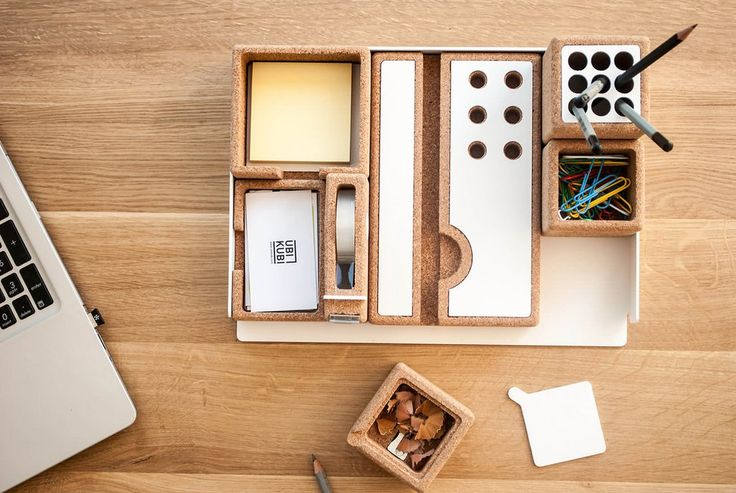 Desk Organiser. This desk offers a contemporary reiteration of the traditional office accessories. This distinctive set provides, by selected materials, consisting of cork and white painted aluminium, a creative fusion between need and aesthetic.
