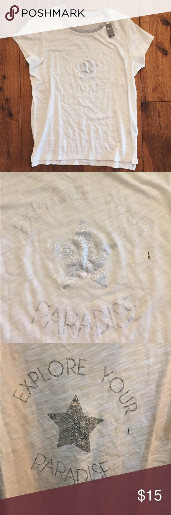 "Aerie ""Real Soft"" White & Silver Tee Super cute ""Real Soft Tee"" from Aerie. Never worn; never even tried on. Shimmery silver words that say ""explore your paradise"" with a star in the middle. Comes with original plastic bag it was shipped in. aerie Tops Tees - Short Sleeve"