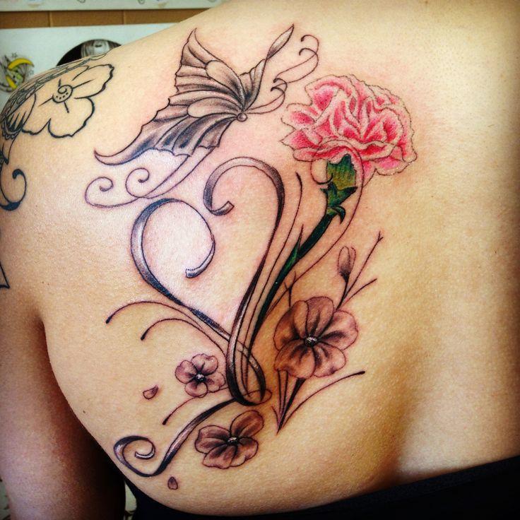 Sunday's tattoo session Carnation flower & infinity heart with butterfly tattoo Tattoo by : Spirits in the Flesh tattoo studio  San Francisco Ca  www.spiritsinthefleshtattoo.com