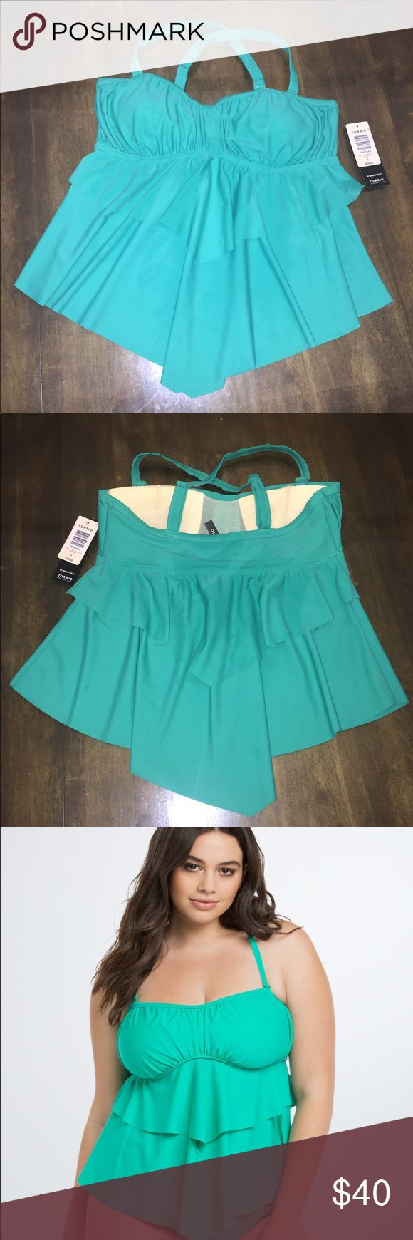 Torrid flounce tankini top Bali green flounce tankini top. Adjustable, multiway straps, built in soft cups. Brand new with tags attached. Size 0 in torrid equals size 12. torrid Swim Bikinis